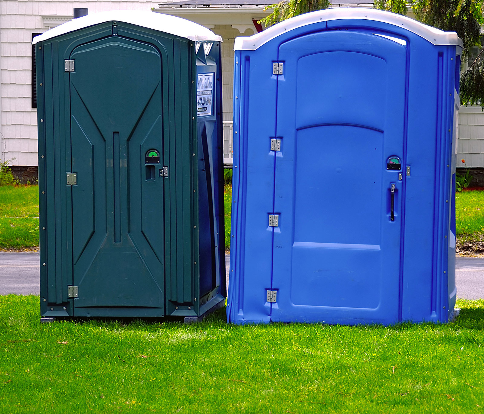 two porta potty on the grass