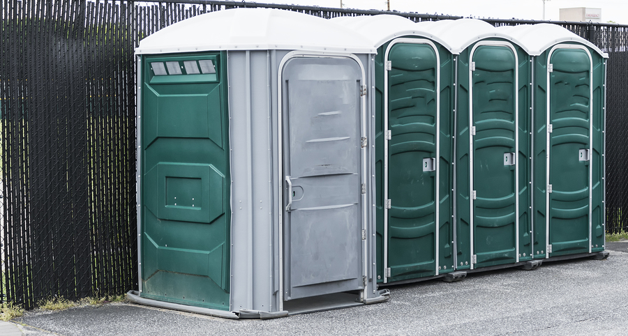 gray and green porta potty